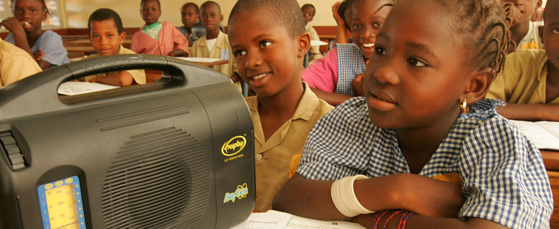 Students listening to an interactive radio instruction lesson