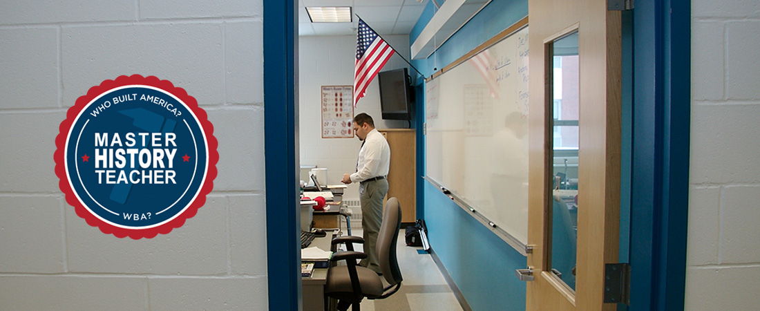A picture of a classroom teacher with a badge