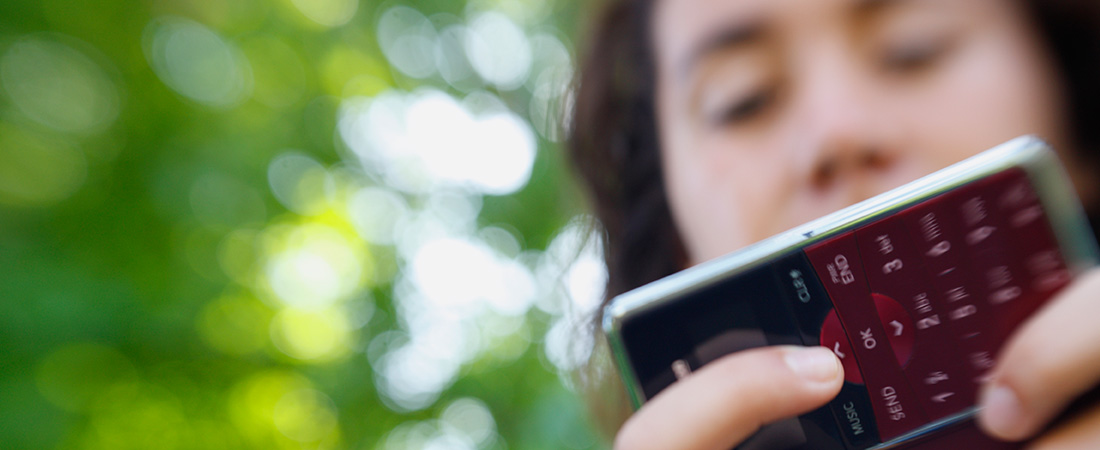 A picture of a teenager sending a text