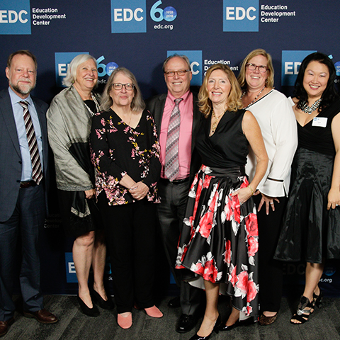 Members of EDC's Leadership Team pose for a photo.
