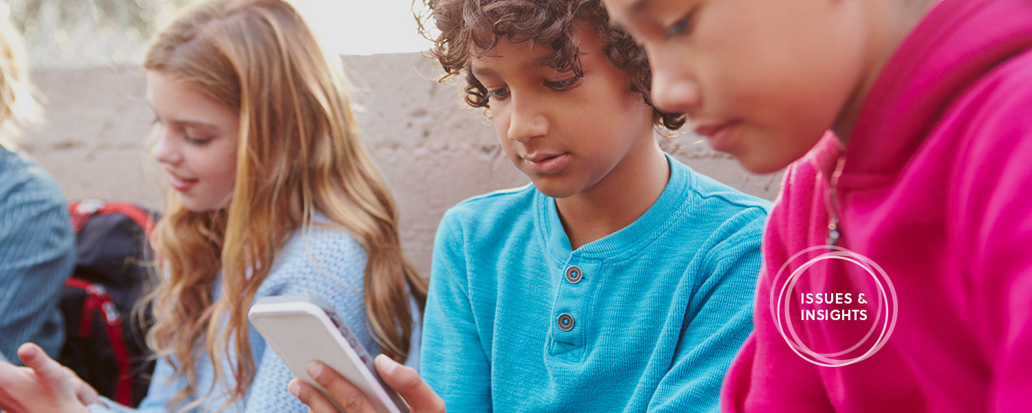 A photo of tweens using technology