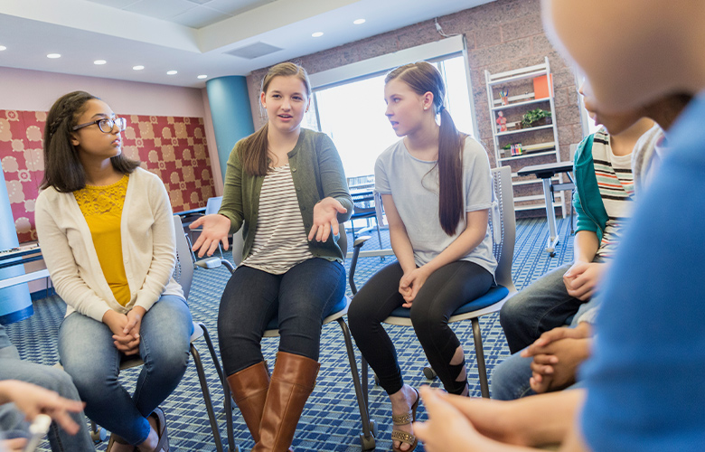 A photo of students having a discussion
