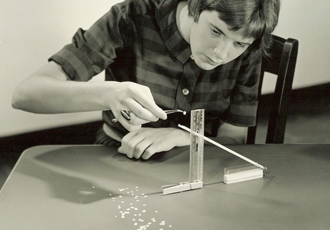 A student using EDC's PSSC Physics program