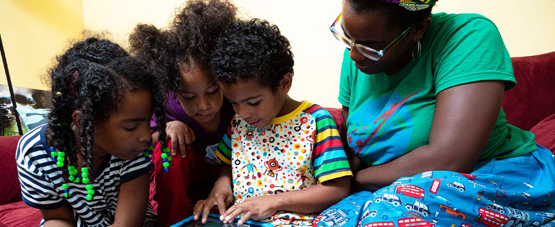 A photo of a family using a tablet
