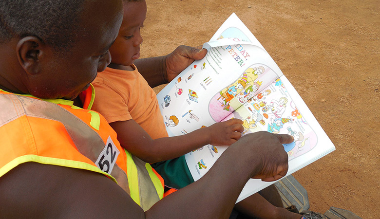 A photo of parent and child reading in Ghana