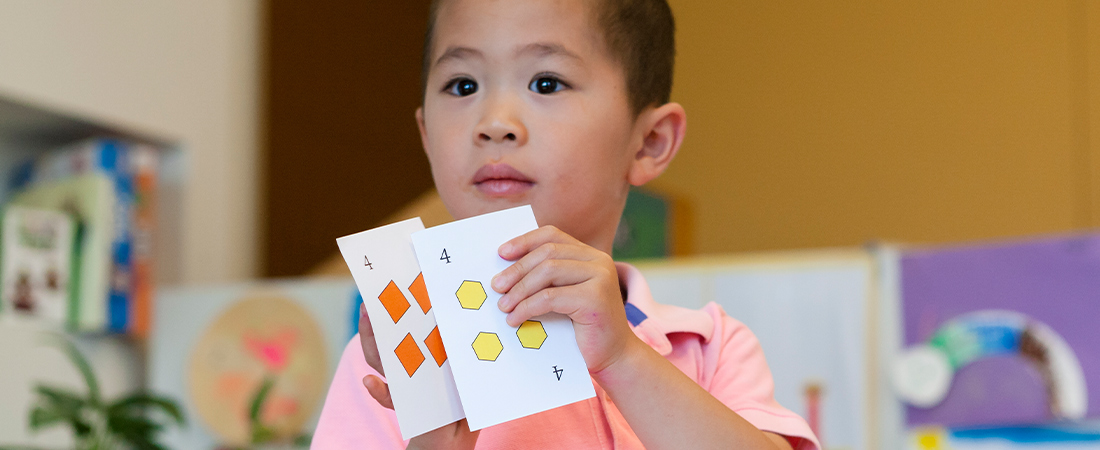 A child playing a math game representing 3 Ways to Promote Social and Emotional Learning through Math