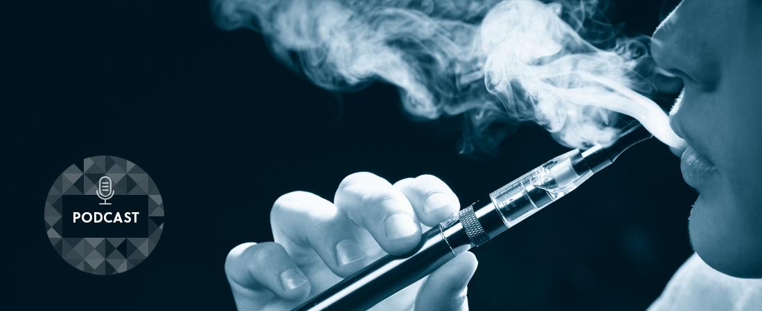 A photo of a person using an e-cigarette
