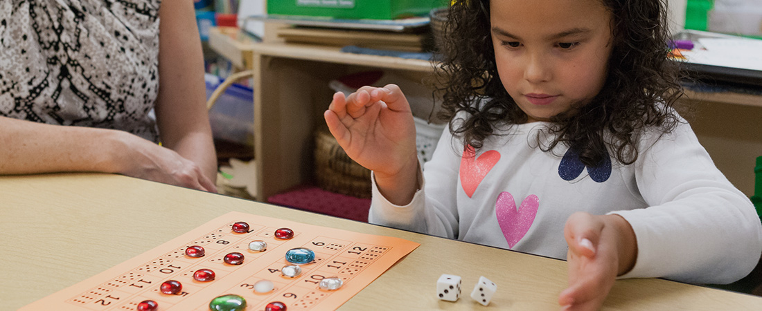 A photo of a preschooler playing a math game