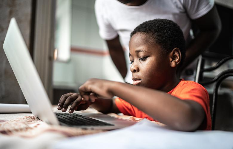 A photo of a child using a computer