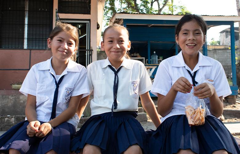 A photo of students representing Adolescent Girls Need More than Paper Dreams