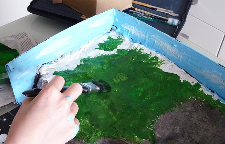 A photo of a person painting representing Engaging Students through Performance Assessment