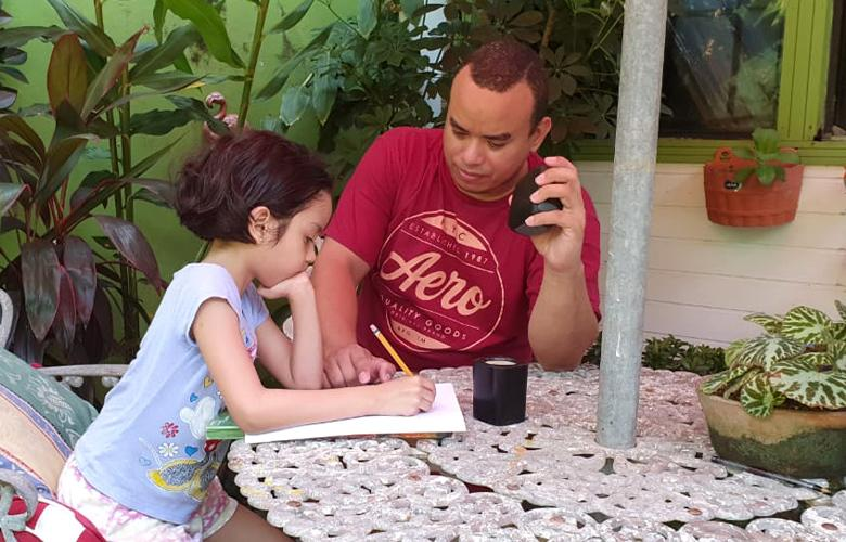 A photo of parent and child learning at home representing International Literacy Day—September 8