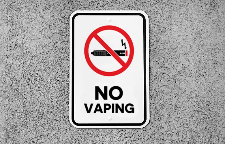 A photo no vaping sign to represent Reducing Teen Vaping: States and Communities Take the Lead