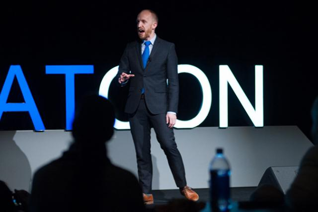 EDC's Adam Swanson giving a presentation in 2016