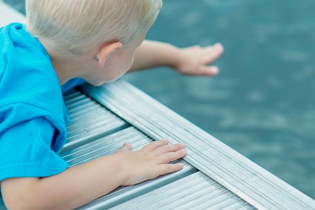 A photo of a child near a pool