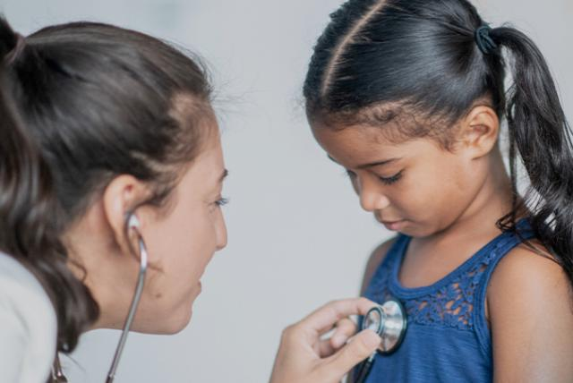 A photo of a doctor and child patient