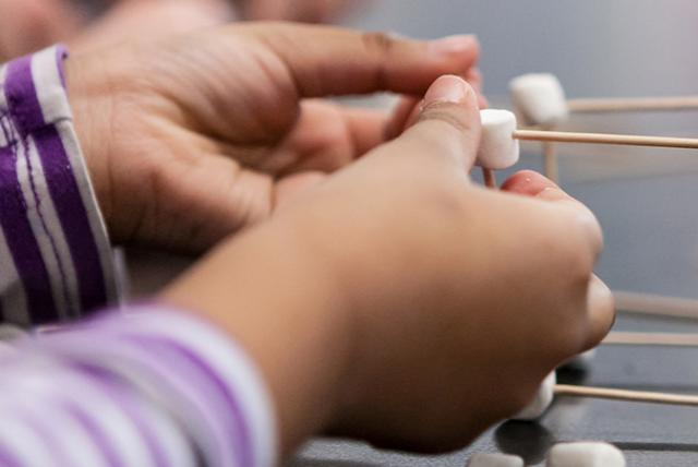 A photo of a child engaged in scientific activity