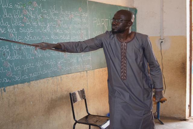 A photo of a teacher in Mali