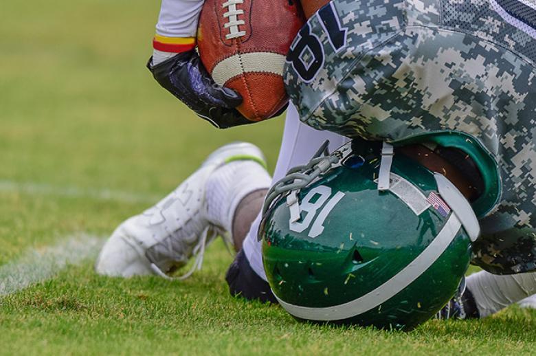 Student athletes playing football