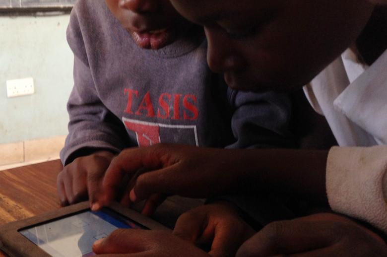 Image of Zambian students using Vernacular