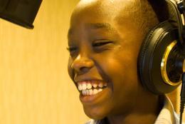 Billy Niyingabiye recording a program for L3