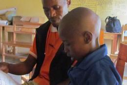 Reading together in a Rwandan classroom