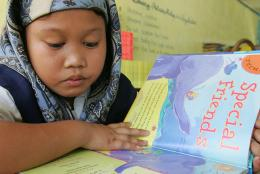 A child in the Philippines reading a book.