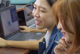 A photo of women using a computer.