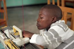A photo of a youth in Rwanda representing Making it Happen—One Year Later