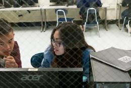 Photo of students using a computer