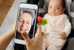 A photo of an older adult using facetime