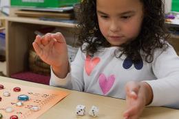 A photo of a preschooler playing a math game